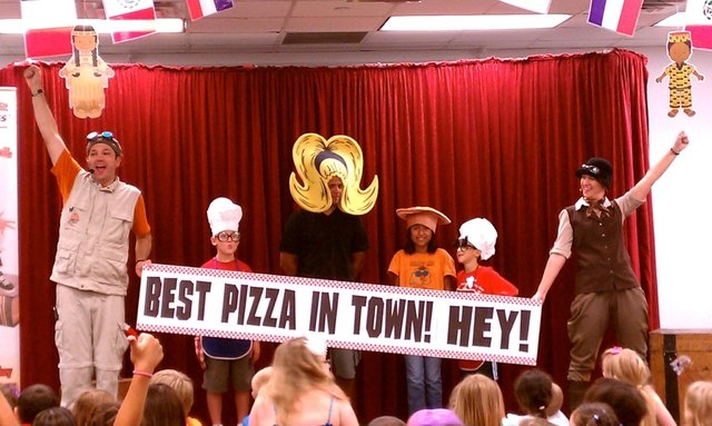 """Kenny Mikey, left, and Riley Roam, right, bring audience members on stage during a performance of """"The Great Pizza Contest,"""" slated at 7 p.m. July 8 at the Charleston Heights Arts Center and 1 ..."""