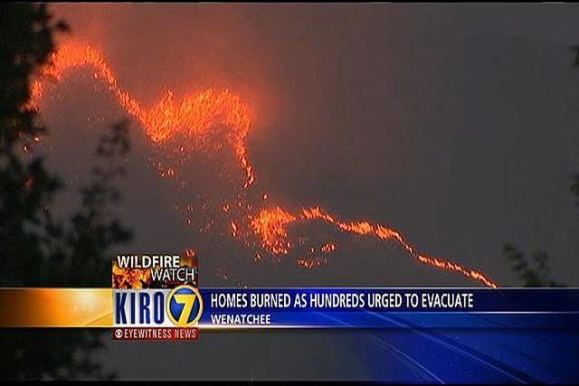 A wildfire fueled by high temps and strong winds roared into a central Washington neighborhood, forcing more than a thousand people to flee their homes and destroying a dozen structures. There als ...