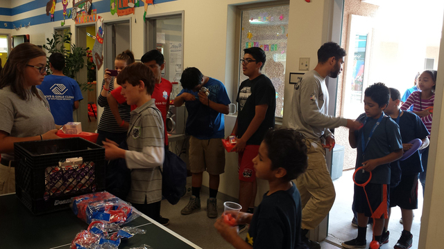 AmeriCorps National Civilian Community Corps volunteers provide Three Square meals to attendees during the Summer Food Kickoff Carnival May 16 at Desert Pines Boys & Girls Club, 3750 E. Bonanza Ro ...