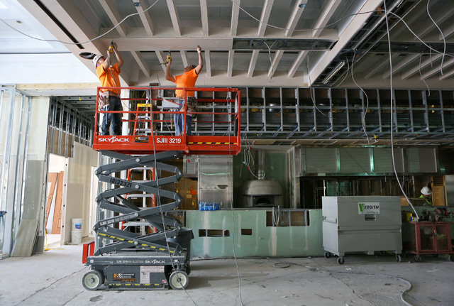 Cruz Chavarria, left, and Gerardo Guardado, both of Vergith Contracting, work on the construction of Salute at Red Rock hotel-casino Wednesday, June 3, 2015, in Las Vegas. The new Italian restaura ...