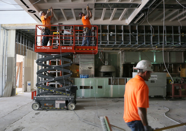Cruz Chavarria, left, and Gerardo Guardado, center, both of Vergith Contracting, work on the construction of Salute at Red Rock hotel-casino Wednesday, June 3, 2015, in Las Vegas. The new Italian  ...