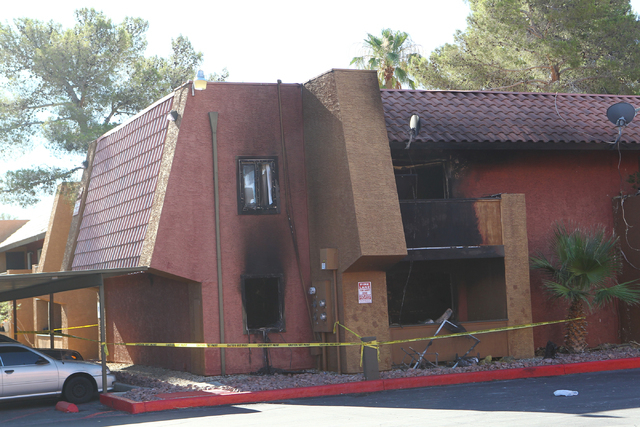 Damaged apartments are seen after an early morning fire injured one person at Sundance Village Apartments on near Charleston and Rainbow boulevards in Las Vegas on Wednesday, June 17, 2015. (Chase ...