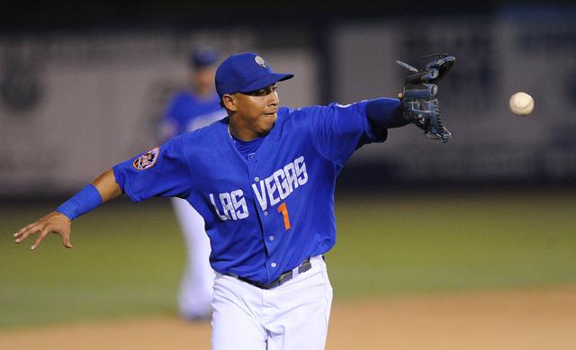 Las Vegas shortstop Wilfredo Tovar fields a Sacramento River Cats base hit in the eighth inning of their Triple-A minor league baseball game at Cashman Field Saturday June 27, 2015. Las Vegas won  ...