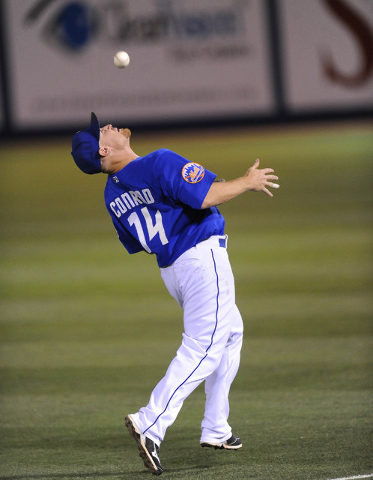 Las Vegas first baseman Brooks Conrad is unable to make the catch on this Sacramento River Cats base hit in the sixth inning of their Triple-A minor league baseball game at Cashman Field Saturday  ...