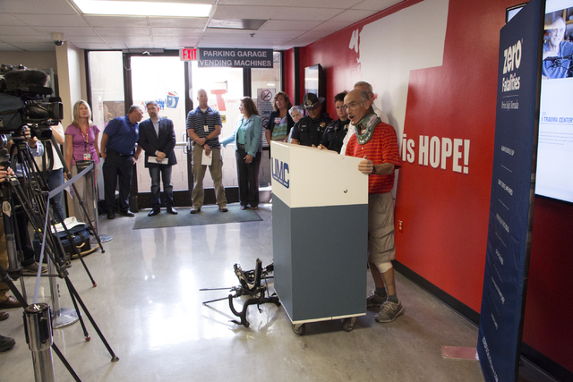 Roger Swain speaks about bike safety in front of his mangled bicycle at University Medical Center, Monday, June 29, 2015. Swain was struck by a car earlier this month. (Ricardo Torres/Las Vegas Re ...