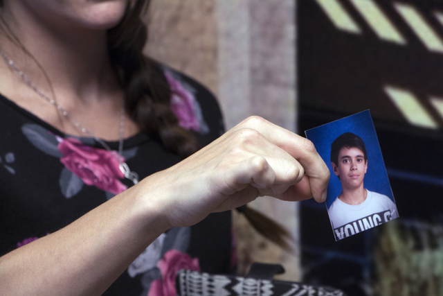 Sarah Owens shows a photo of her son, Cameron DeMaranville, during a bike safety event at University Medical Center, Monday, June 29, 2015. Cameron was killed when he was struck by a car in Februa ...