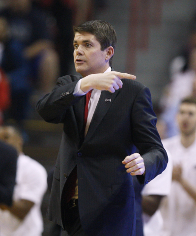 UNLV head coach Dave Rice positions his players during the first half of their Mountain West Conference game against San Diego State Wednesday, March 4, 2015, at the Thomas & Mack Center. (Sam Mor ...