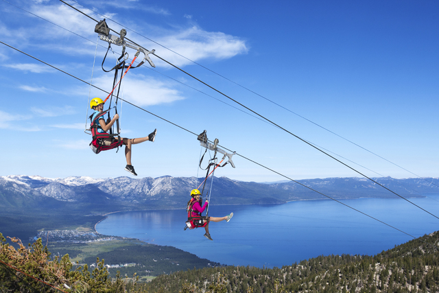 Two thrill-seekers ride the Heavenly Blue Streak zip line at Heavenly Mountain Resort, South Lake Tahoe, Calif. (COURTESY PHOTO)