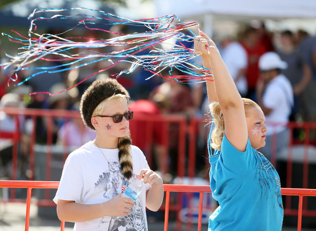 "Nathaniel Corthell, 11, left, and his sister Chyann (cq), 12, wait for the start of the 66th Annual Boulder City Damboree Celebration ""Wings of Freedom"" parade Friday, July 4, 2014, in B ..."