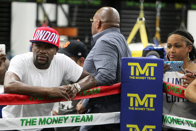 Floyd Mayweather, left, watches as people box at the Floyd Mayweather Boxing Club on Wednesday, June 17, 2015, in Las Vegas. Shawn Porter and Adrien Broner will fight this Saturday at the MGM. (Ja ...