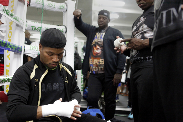 Shawn Porter wraps his hands before practicing at the Floyd Mayweather Boxing Club on Wednesday, June 17, 2015, in Las Vegas. Shawn Porter and Adrien Broner will fight this Saturday at the MGM. (J ...