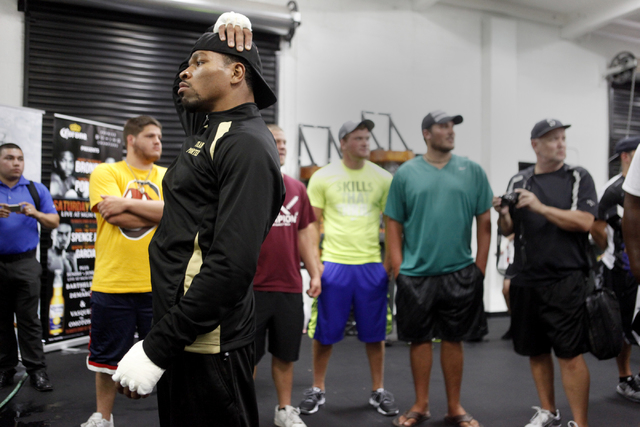 Shawn Porter stretches before practicing at the Floyd Mayweather Boxing Club on Wednesday, June 17, 2015, in Las Vegas. Shawn Porter and Adrien Broner will fight this Saturday at the MGM. (James T ...