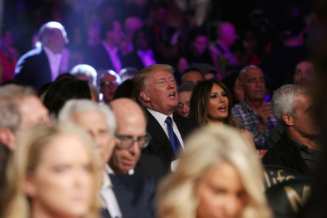 Donald Trump, center, attends the Floyd Mayweather Jr.-Manny Pacquiao welterweight unification boxing match at the MGM Grand Garden Arena in Las Vegas on Saturday, May 2, 2015. (Sam Morris/Las Veg ...