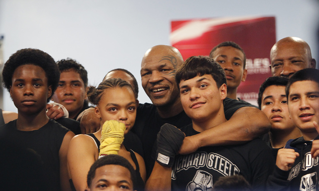 Former heavyweight champion Mike Tyson poses for a photo with his pupils after teaching a boxing clinic to a group of children at the Richard Steele Boxing Club in North Las Vegas on Saturday, Jan ...