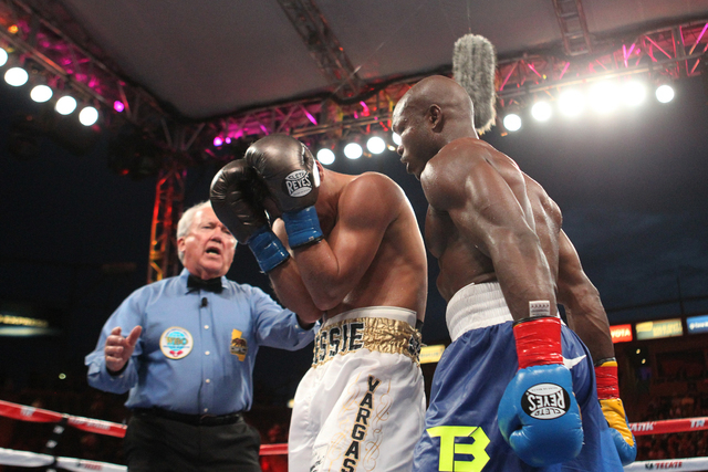 Jessie Vargas, left, covers his head from Timothy Bradley Jr., in the ninth round of their World Boxing Organization interim welterweight title match at StubHub Center in Carson, Calif., on Saturd ...