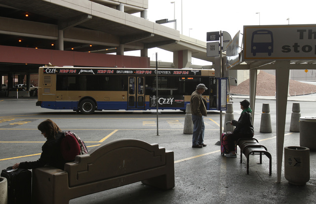 A Regional Transportation Commission of Southern Nevada bus makes a stop in 2014 at Terminal One at McCarran International Airport. The RTC recommends arriving at the bus stop no more than 10 minu ...