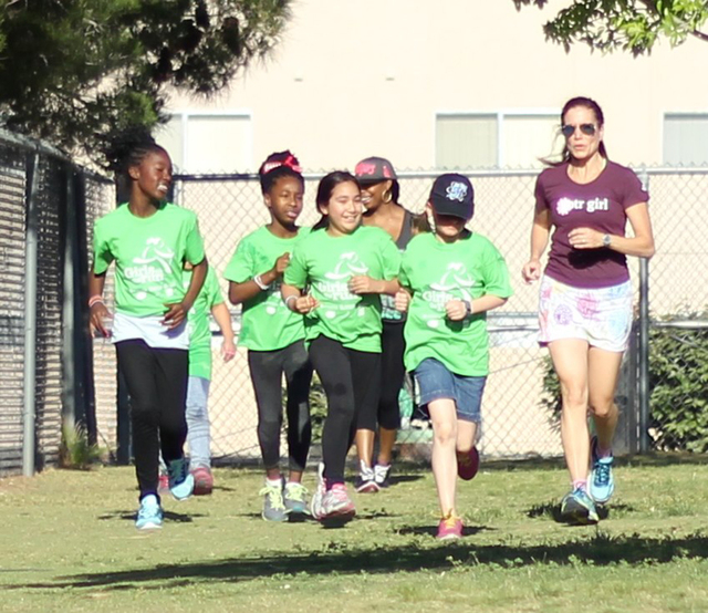 Bridgette Kirvin runs with Girl Scout troops in this undated photo. (Special to View)