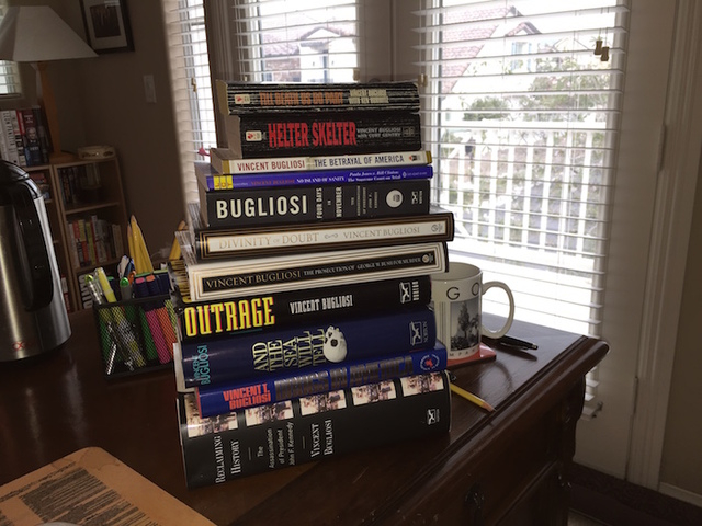 A stack of some of prosecutor-turned-author Vincent Bugliosi's books. Bugliosi died of cancer on Saturday at the age of 80.