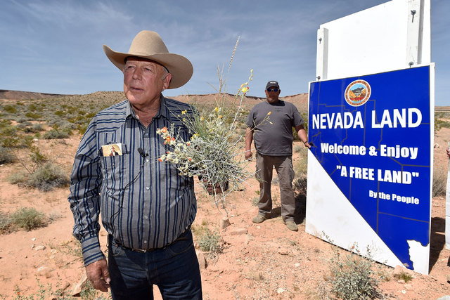 Rancher Cliven Bundy displays a bouquet of desert foliage that his cattle grazes on during a news conference at an event near his ranch in Bunkerville on Saturday, April 11, 2015.  Bundy is hostin ...
