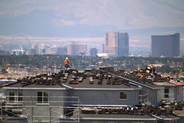 Workers are seen on the roof of an under-construction house in the Cadence master-planned community in Henderson Tuesday, May `19, 2015. (Sam Morris/Las Vegas Review-Journal) Follow Sam Morris on  ...