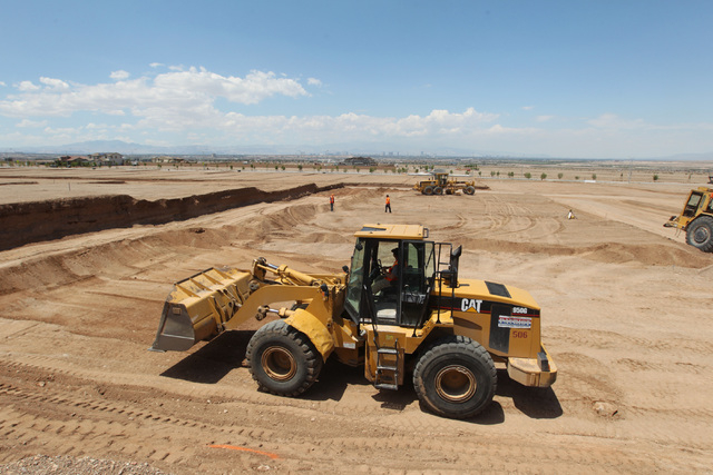 A bulldozer preps land for construction in the Cadence master-planned community in Henderson Tuesday, May `19, 2015. (Sam Morris/Las Vegas Review-Journal) Follow Sam Morris on Twitter @sammorrisRJ