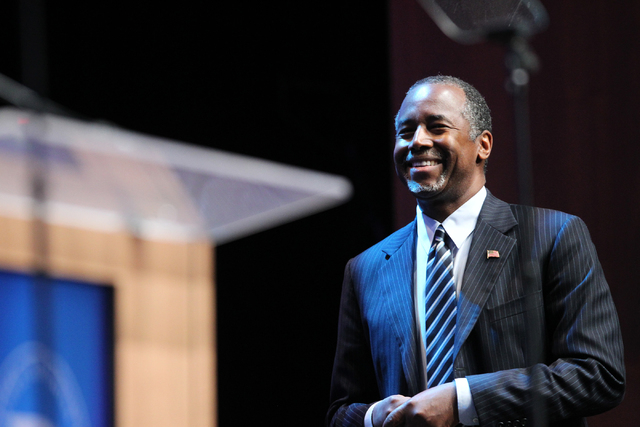 Republican presidential candidate Dr. Ben Carson, a neurosurgeon who is seeking the Republican nomination, walks to the stage to speak during the National Association of Latino Elected and Appoint ...