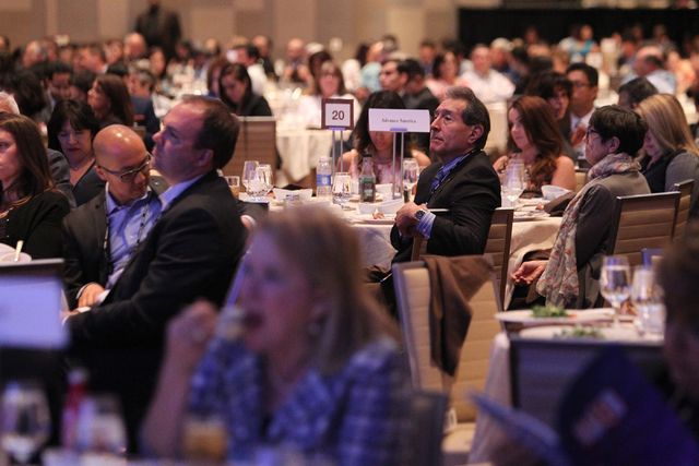Audience members listen to Republican presidential candidate Dr. Ben Carson, a neurosurgeon who is seeking the Republican nomination, speak during the National Association of Latino Elected and Ap ...