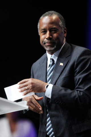 Republican presidential candidate Dr. Ben Carson, a neurosurgeon who is seeking the Republican nomination, leaves the stage after speaking during the National Association of Latino Elected and App ...
