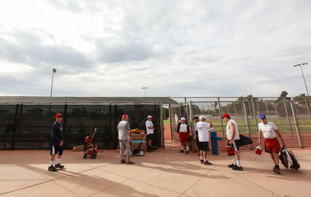 Softball players mingle and head to the fields before the start of the Flag Day Celebration Classic by members of the Las Vegas Senior Softball Association at Lorenzi Park in Las Vegas on Tuesday, ...