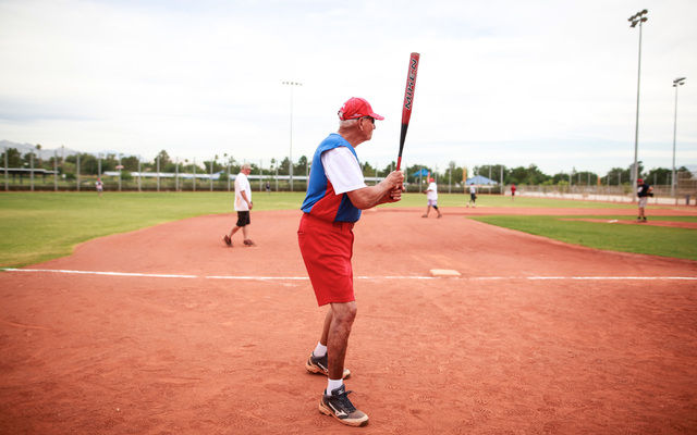Dave Barnes warms up during the Flag Day Celebration Classic by members of the Las Vegas Senior Softball Association at Lorenzi Park in Las Vegas on Tuesday, June 9, 2015. More than 375 senior sof ...