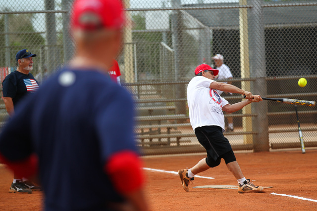 Bobby Castiglione hits the ball before scoring a run during the Flag Day Celebration Classic by members of the Las Vegas Senior Softball Association at Lorenzi Park in Las Vegas on Tuesday, June 9 ...