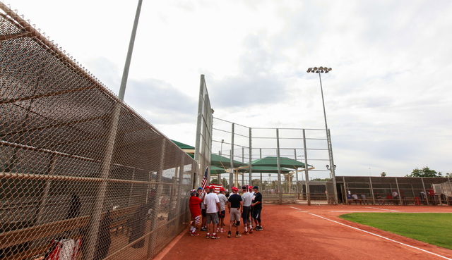 Players huddle before the start of the Flag Day Celebration Classic by members of the Las Vegas Senior Softball Association at Lorenzi Park in Las Vegas on Tuesday, June 9, 2015. More than 375 sen ...