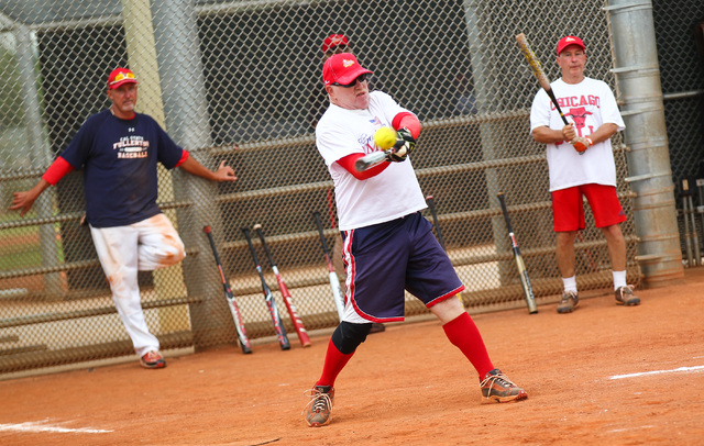 Joe Pellegrino hits the ball during the Flag Day Celebration Classic by members of the Las Vegas Senior Softball Association at Lorenzi Park in Las Vegas on Tuesday, June 9, 2015. More than 375 se ...
