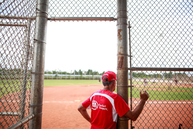 Steve Solomon watches the game during the Flag Day Celebration Classic by members of the Las Vegas Senior Softball Association at Lorenzi Park in Las Vegas on Tuesday, June 9, 2015. More than 375  ...