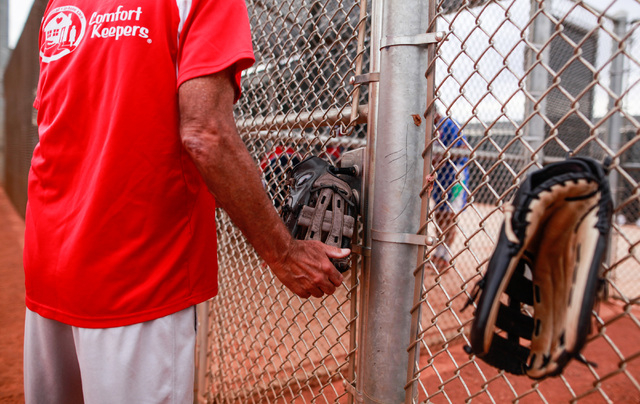 Steve Solomon hangs his glove on the fence during the Flag Day Celebration Classic by members of the Las Vegas Senior Softball Association at Lorenzi Park in Las Vegas on Tuesday, June 9, 2015. Mo ...