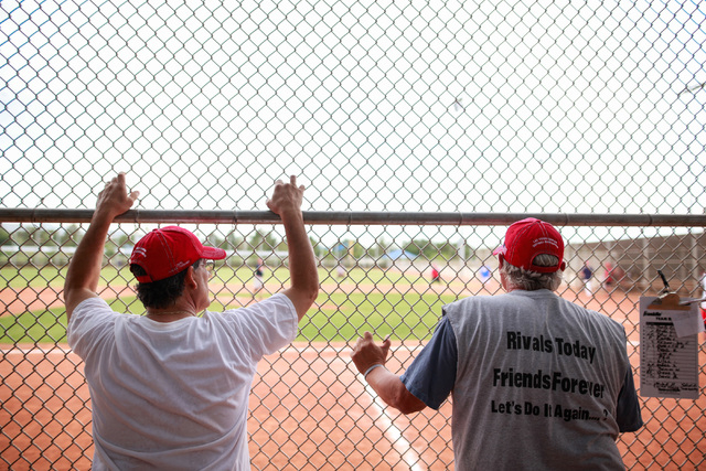 Bobby Castiglione, left, and Dan Lobue watch the game during the Flag Day Celebration Classic by members of the Las Vegas Senior Softball Association at Lorenzi Park in Las Vegas on Tuesday, June  ...