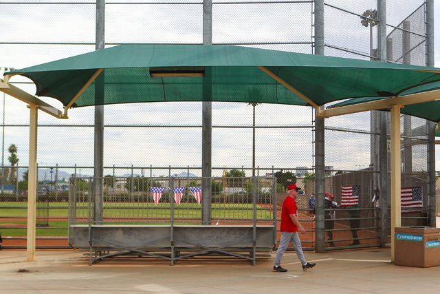 A softball player walks to the field before the start of the Flag Day Celebration Classic by members of the Las Vegas Senior Softball Association at Lorenzi Park in Las Vegas on Tuesday, June 9, 2 ...