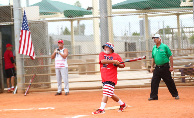 Wayne Callahan hits the ball during the Flag Day Celebration Classic by members of the Las Vegas Senior Softball Association at Lorenzi Park in Las Vegas on Tuesday, June 9, 2015. More than 375 se ...