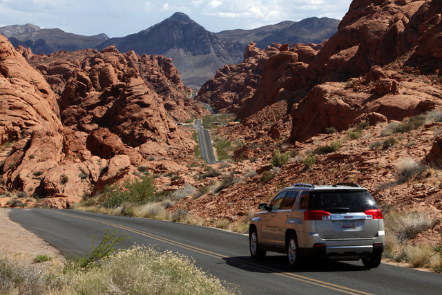 A car passes through the Valley of Fire on Saturday, June 13, 2015, in Overton. Nevada opened up all 23 of their state parks for one day without an admission fee. (James Tensuan/Las Vegas-Review J ...