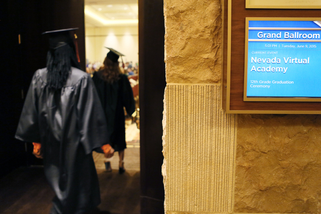 Nevada Virtual Academy high school graduates file into a ballroom at the start of the class of 2015 commencement ceremony at Aliante hotel-casino Tuesday, June 9, 2015, in North Las Vegas. More th ...