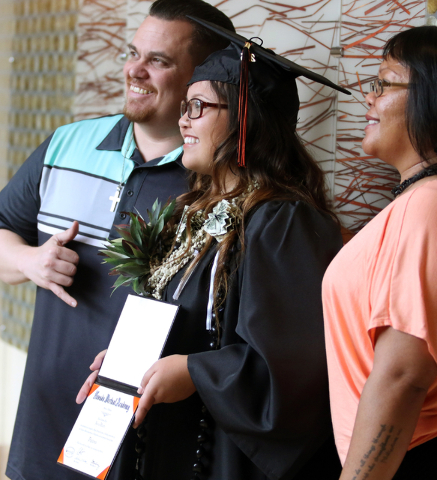 Nevada Virtual Academy high school graduate graduate Alexa Hantz, center, stands for a personal photo with her parents Rodney and Cappy Hantz after a class of 2015 commencement ceremony at Aliante ...