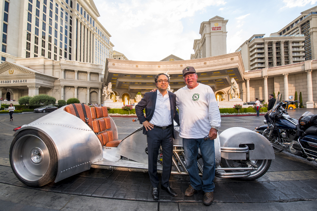 Tariq Shaukat, the Chief Commercial Officer of Caesars Entertainment, left, poses for a photo with William Shatner in front of the Rivet motorcycle, which Shatner designed, at Caesars Palace on Mo ...