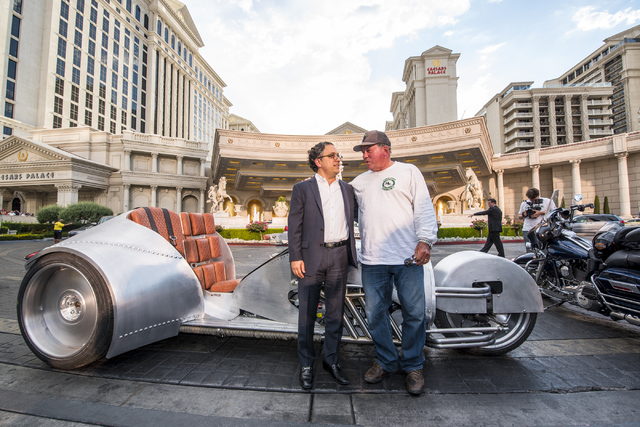 Tariq Shaukat, the Chief Commercial Officer of Caesars Entertainment, left, talks with William Shatner in front of the Rivet motorcycle, which Shatner designed, at Caesars Palace on Monday, June 2 ...