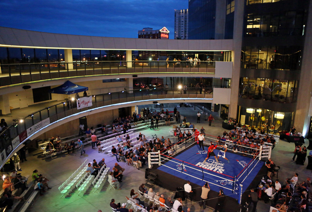 Fighters participate in Downtown Throwdown at Zappos headquarters Tuesday, June 9, 2015, in Las Vegas. Bouts included matchups of local fighters and community workers, and a portion of the proceed ...