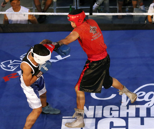 Turner Thompson, right, lands a punch while fighting Eric Watts during the Downtown Throwdown event at Zappos headquarters Tuesday, June 9, 2015, in Las Vegas. Bouts included matchups of local fig ...