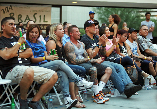 People attend the Downtown Throwdown event at Zappos headquarters Tuesday, June 9, 2015, in Las Vegas. Bouts included matchups of local fighters and community workers, and a portion of the proceed ...