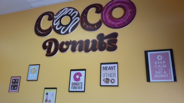 "Signs promoting the ""doughnut lifestyle"" are shown on the wall at Coco Donuts, 10040 W. Cheyenne Ave., Suite 145. (Lisa Valentine/View)"