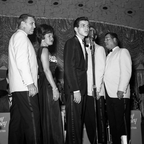 Frank Sinatra Jr. performs with the Tommy Dorsey Orchestra on stage at the Driftwood Lounge located inside the Flamingo Hotel and Casino in Las Vegas on August 8, 1963. (Las Vegas News Bureau archive)
