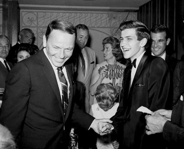Frank Sinatra and son Frank Sinatra Jr. share a laugh at the Flamingo Hotel and Casino in Las Vegas on August 8, 1963. (Las Vegas News Bureau archive)