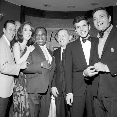 Louis Armstrong, third from left, celebrates his 50th anniversary in show business during a party at the Riviera Hotel and Casino in Las Vegas on August 15, 1965. Also in the photo are comedian No ...